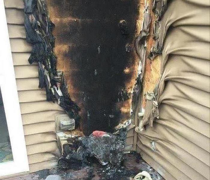 The siding of a home badly burned