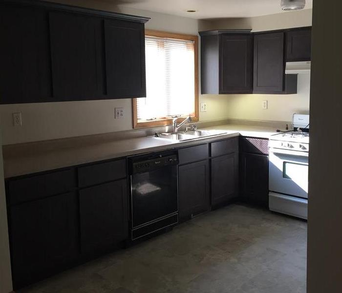 Kitchen with brand new dark wood cabinets with a new tile floor